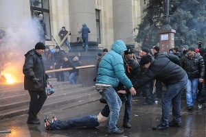 Pro-Russian protesters drag a wounded man during clashes with supporters of Ukraine's new government in central Kharkiv